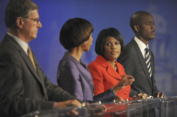 "A mayoral debate was held at Maryland Public Television. From left: Joseph ""Jody"" T. Landers III listens to an answer by Sen. Catherine E. Pugh as Mayor Stephanie Rawlings-Blake watches Sen. Pugh,and Otis Rolley looks toward the panelists."