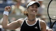 "Five-time Grand Slam singles champion Martina Hingis, 32, was elected to the <a href=""http://www.tennisfame.com/class-of-2013-martina-hingis-thelma-coyne-long-cliff-drysdale-charlie-pasarell-ion-tiriac"">International Tennis Hall of Fame</a> on Monday. Hingis won 15 major titles, including nine in women's doubles and one in mixed. The first came at Wimbledon in women's doubles in 1996, at the age of 15 years, 9 months, making her the youngest Grand Slam event champion in  history."