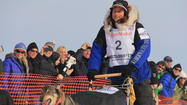 Four-time Iditarod Trail Sled Dog Race champion Martin Buser was the first musher out of the starting chute and has the early lead in the nearly 1,000-mile race from Anchorage to Nome.