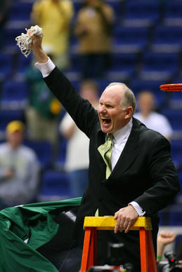 George Mason coach Jim Larranaga takes down the net after the Patriots won the 2008 CAA championship in Richmond.