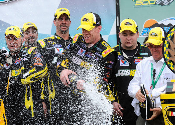 NASCAR Sprint Cup Series driver Carl Edwards (99) celebrates in victory lane after winning the Subway Fresh Fit 500 at Phoenix International Raceway.