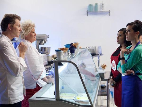 "From left, Bobby Flay and Anne Burrell stand opposite two contestants on ""Worst Cooks in America."""