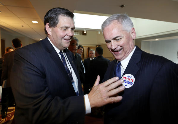 Jim Brulte, the new leader of the California Republican Party, places a campaign sticker on GOP Rep. Tom McClintock, at the California Republican Party convention on Saturday.
