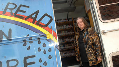 Eve Kline on the steps of the Somerset County Federated Library Systems bookmobile.