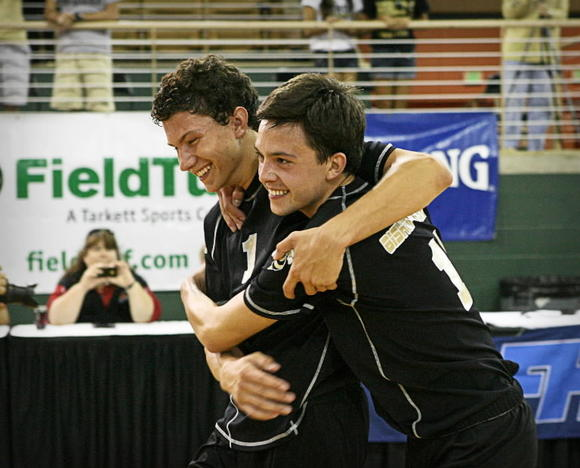 Bishop Moore's Christian Malias, left, and Christian Franceschi hug after the Hornets won the state boys volleyball title last year. Franceschi has graduated, leaving Malias with the leadership role. (Joshua C. Cruey, Orlando Sentinel)