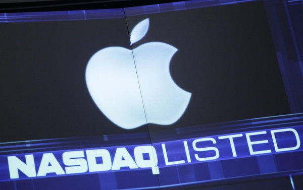 The Apple logo is shown on a Nasdaq stock ticker in New York.