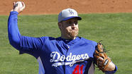 PHOENIX -- Most of the Dodgers had Monday off. But it was a work day for right-hander Aaron Harang, who is part of a crowded field battling for a spot in the starting rotation.
