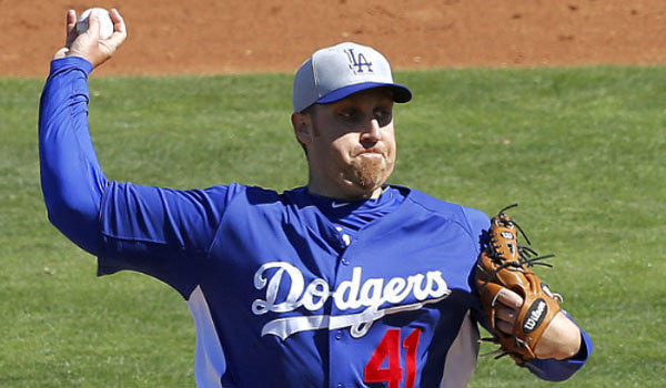 Aaron Harang, shown during a spring training game, is one of several pitchers vying for precious few spots in the Dodgers' rotation.