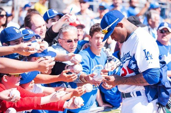 Carl Crawford signs autographs at spring training last month.