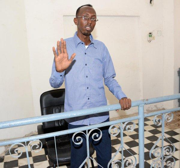 Somali journalist Abdiaziz Abdinur Ibrahim gestures at a courthouse in Mogadishu on Sunday.