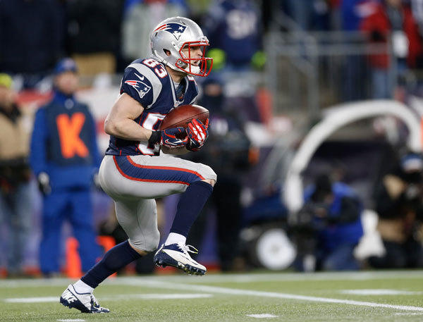 New England Patriots wide receiver Wes Welker (83) carries the ball during a punt return during the third quarter against the Baltimore Ravens at Gillette Stadium.