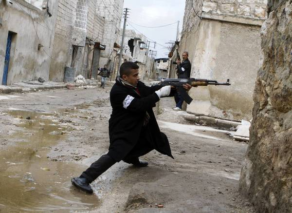 A Syrian rebel aims his weapon during clashes with government forces in the streets near Aleppo international airport in northern Syria. Syria is locked in a nearly two-year-old conflict in which the United Nations estimates that more than 70,000 people have been killed.