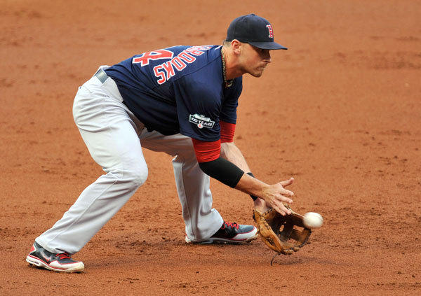 Boston Red Sox third baseman Will Middlebrooks (64) fields a ground ball in the first inning against the Cleveland Indians at Progressive Field.