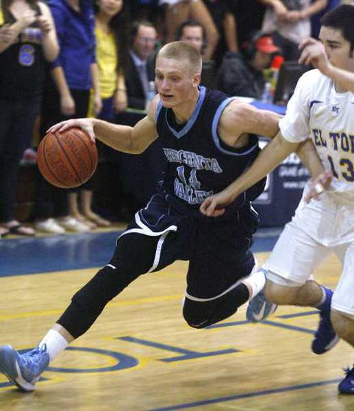 Crescenta Valley's Cole Currie drives to the basket against El Toro's Liam Skelly at El Toro High School in Lake Forest in a CIF Division 1A semifinal boys basketball game on Tuesday, February 26, 2013. (Tim Berger/Staff Photographer)