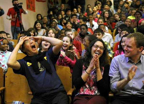 "Cellist Yo-Yo Ma reacts in mock surprise at the ovation he receives from Chicago Public School students at Swift Elementary School in Chicago. Ma later performed as part of the ""Citizen Musician"" program of the Chicago Symphony Orchestra (CSO) for Swift students and students from Waters Elementary School in an assembly that also showcased student work focusing on rivers and waterways."