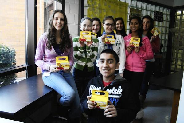 Glenview's Springman Middle School students, who are part of the school's Builder's Club, pose with their collection boxes, which they use for gathering change, on Monday, Feb. 25. The students are participaing in a three-week fundraiser that benefits children with blood cancer.