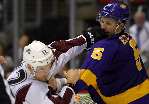 Kings defenseman Keaton Ellerby, right, fights Colorado Avalanche right wing Chuck Kobasew.