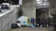 Homeless advocates and a city councilwoman sharply criticized Monday a Rawlings-Blake administration plan to remove an encampment of about a dozen homeless people this week from under the Interstate 83 overpass in central Baltimore.
