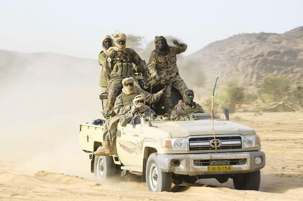 "Malian troops patrol in the Ifoghas mountains as part of their joint effort with France to drive out Islamist militants. French officials said it was ""probable"" that regional Al Qaeda leader Abou Zeid had been killed in an airstrike."