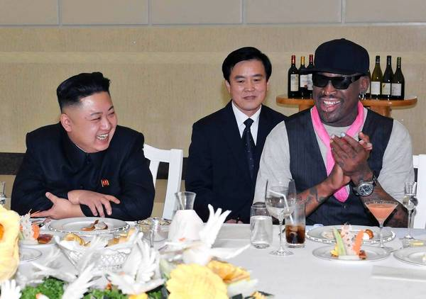 North Korean leader Kim Jong-Un (C), his wife Ri Sol-Ju (L) and former NBA basketball player Dennis Rodman (R) talk in Pyongyang in this undated picture released by North Korea's KCNA news agency. KCNA reported that a mixed basketball game of visiting U.S. basketball players and North Korean players was held at Ryugyong Jong Ju Yong Gymnasium in Pyongyang on February 28, 2013.