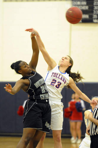 Northwest Catholic forward Alyssa Reaves, left, and Tolland High School forward Chelsea Domian battle for the tip-off to start the game. Tolland High School beat Northwest Catholic in the CIAC Class L girls basketball quarterfinals, 50-36.