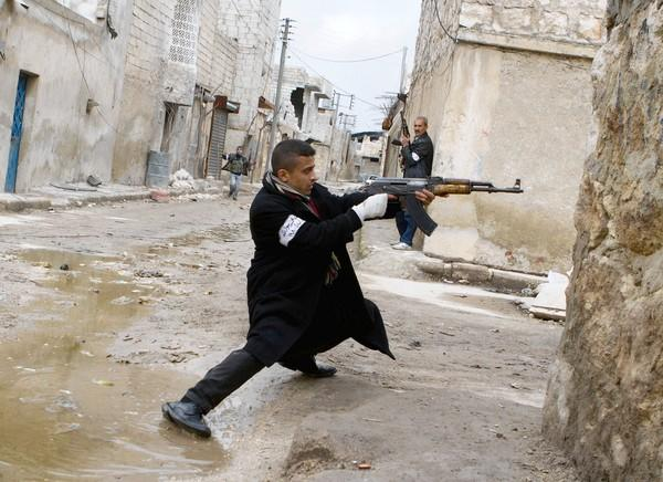 A Syrian rebel takes aim during clashes with government forces near the city of Aleppo.