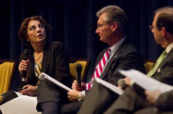 Camelia Ravanbahkt (left), deputy director of the Hampton Roads Transportation Planning Organization, looks up to a slideshow presentation during a transportation town hall meeting at Christopher Newport University on Monday evening.