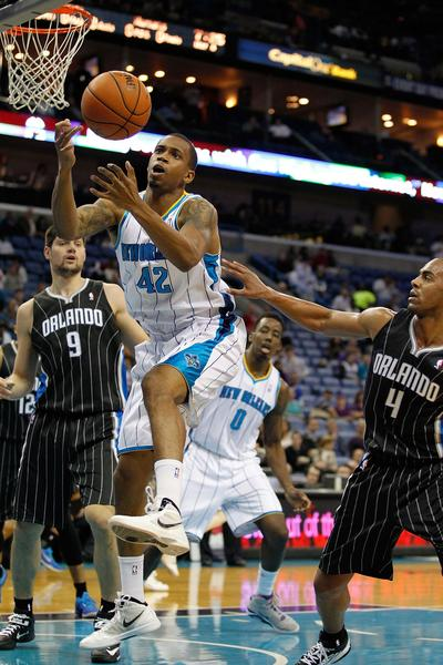 New Orleans Hornets forward Lance Thomas (42) goes up for a lose ball over Orlando Magic guard Arron Affalo (4) during the game at New Orleans Arena.