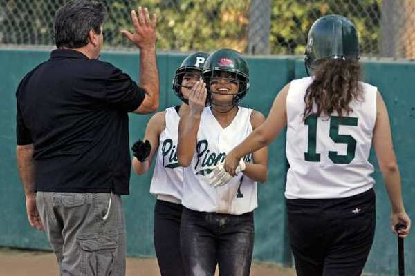 Providence's Tabitha Taylan and Ashley Corral get congratulations after scoring runs against Sherman on Monday, March 4, 2013.