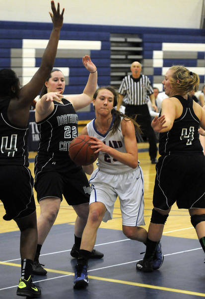 Tolland High School forward Chelsea Domian drives past Northwest Catholic's Megan Schuppe, left, and Alison Connors, right.
