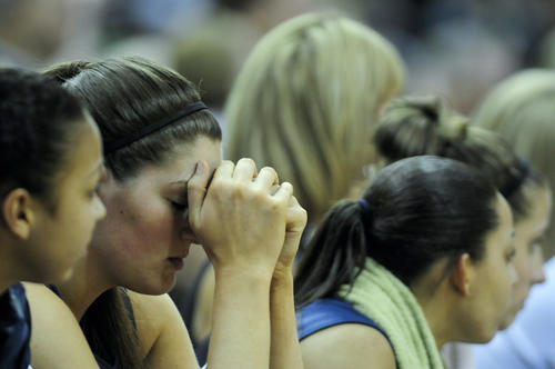 UConn center Stefanie Dolson can't watch the final seconds of the regular season finale against Notre Dame. The third-ranked UConn women lost to the second-ranked Notre Dame Fighting Irish in triple overtime.