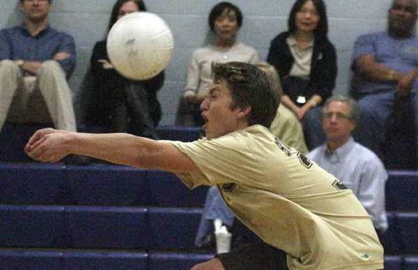 St. Francis' libero John Romo bumps the ball against Flintridge Prep in a non-league boys volleyball match at Flintridge Prep in La Canada Flintridge on Monday, March 4, 2013.(Tim Berger/Staff Photographer)