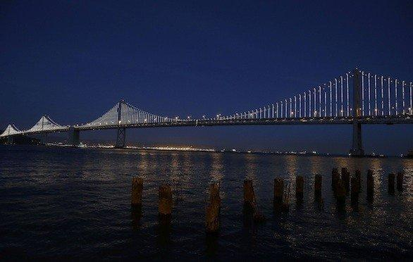 The light sculpture on the San Francisco-Oakland Bay Bridge was illuminated temporarily in February. The light sculpture will officially be lighted Tuesday night.