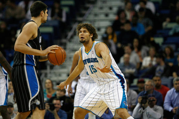 New Orleans Hornets center Robin Lopez (15) guards Orlando Magic center Nikola Vucevic (9) during the game at New Orleans Arena.