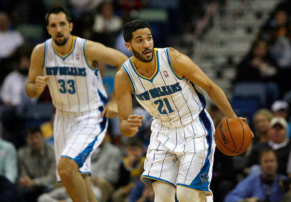 New Orleans Hornets guard Greivis Vasquez (21) and New Orleans Hornets forward Ryan Anderson (33) in action against the Orlando Magic during the game at New Orleans Arena. M