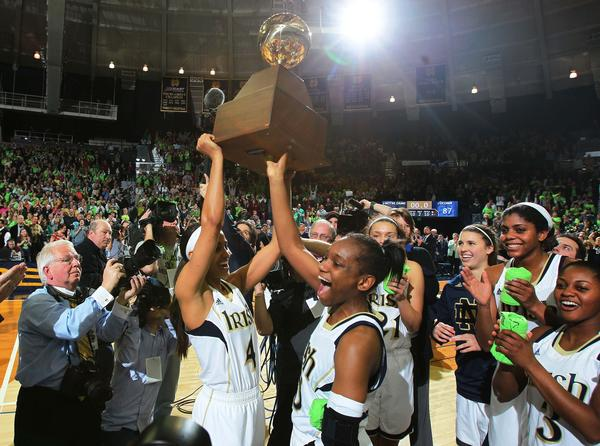 Skylar Diggins and Kaila Turner hold up the Big East Championship League Trophy after defeating Connecticut.