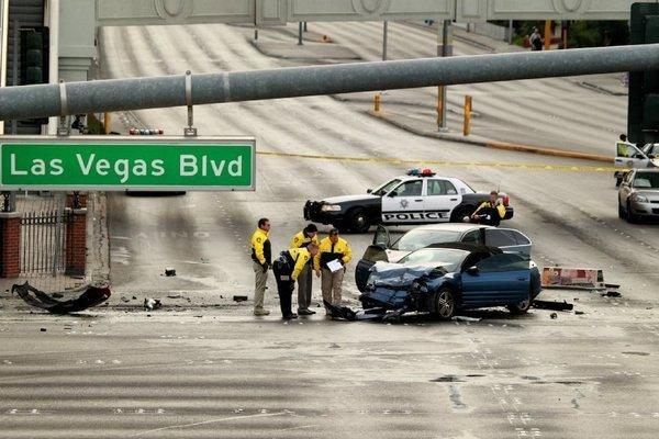 A wild shooting attack on the Las Vegas Strip early Thursday morning caused a fiery crash with a taxi and left three people dead.