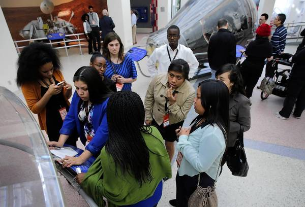 The team from Fairfax High School finishes an exercise as part of the Aspen Challenge at the California Science Center.