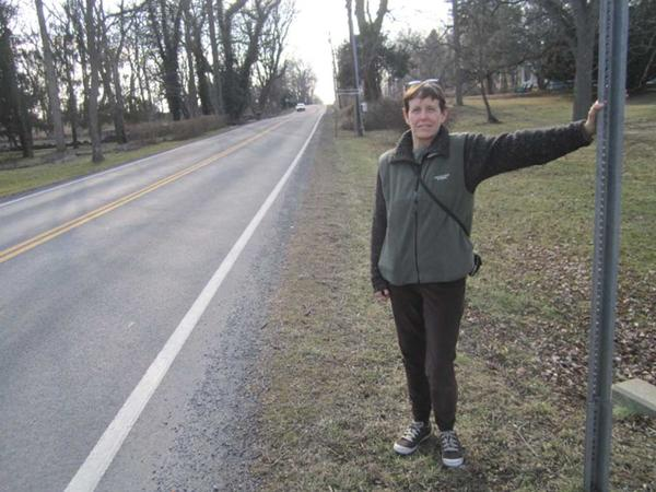Shepherdstown (W.Va.) Town Recorder Lori Robertson stands along W.Va. 480, where she hopes to one day see a bike path.