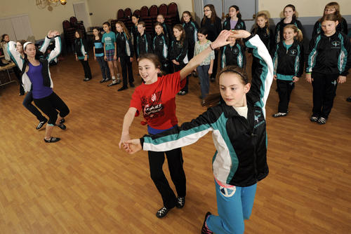 Maddie Killian, center, 12, of Loch Raven Village, and Hailey Russo, right, 11, of Lutherville, rehearse with the McHale School of Irish Dance in Towson. The school's dancers will perform in Baltimore's St. Patrick's Day parade March 10.