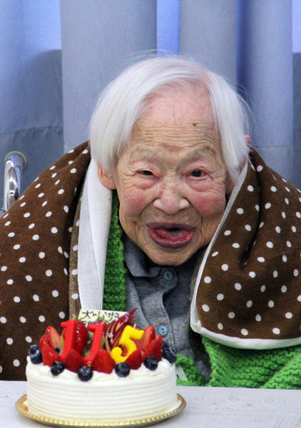 This handout picture taken by Tomohito Okada from the Kurenai nursing home on March 5, 2013 shows the world's oldest woman Misao Okawa celebrating her 115th birthday at the nursing home in Osaka, western Japan. Okawa, who late last month received a certificate from Guinness World Records confirming her status as the oldest living woman, celebrated her 115th birthday on March 5 in a Japanese nursing home with her favorite mackerel sushi dish on the menu.