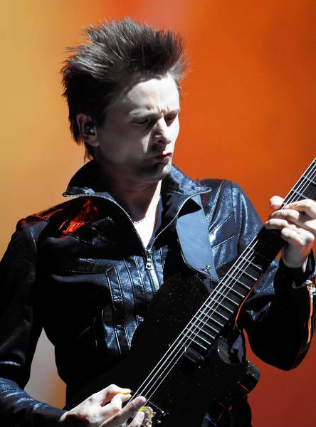Muse guitarist Matthew Bellamy performs during a concert at the United Center on Monday evening.