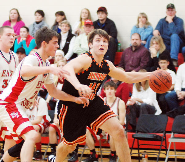 Harbor Springs senior forward Spencer Kloss (right) finished with a game-high 23 points and nine rebounds Monday as the Rams defeated Newberry, 62-41, in a Class C district contest at the Harbor Springs High School gym.