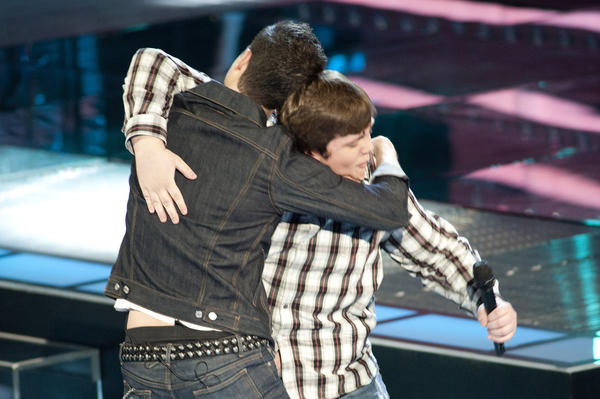 Judge and coach Adam Levine hugs Jeff Jenkins on NBC's The Voice.