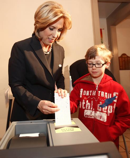 Mayoral candidate Wendy Greuel casts her ballot with her son Thomas, 7, at a Studio City polling location.