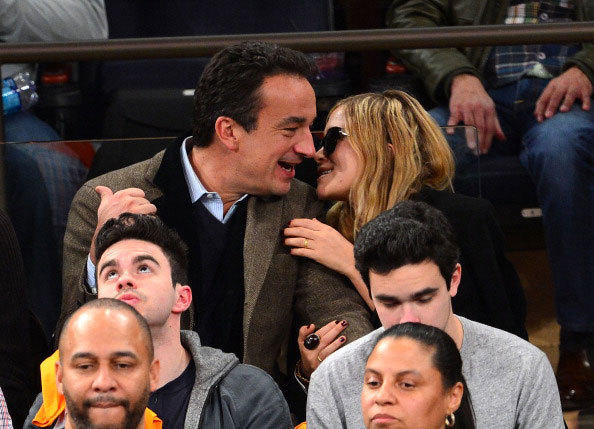 Olivier Sarkozy and Mary-Kate Olsen attend the Miami Heat vs New York Knicks game at Madison Square Garden on March 3, 2013 in New York City.