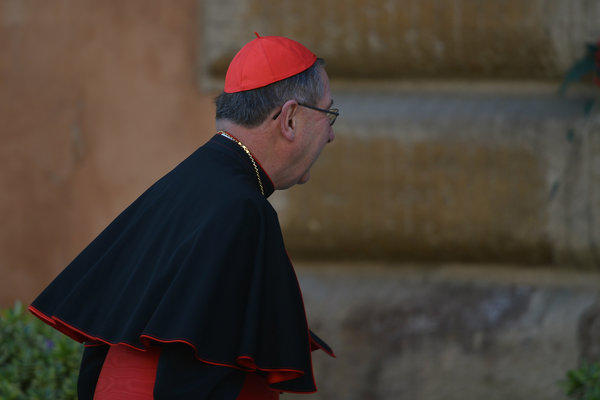 Cardinal Roger Mahony arrives at the Vatican for talks ahead of a conclave to elect a new pope.
