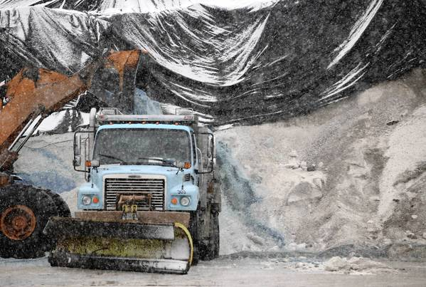 Salt is loaded into a salt truck at the Streets and Sanitation Department salt storage site at Grand Avenue and Rockwell Street.