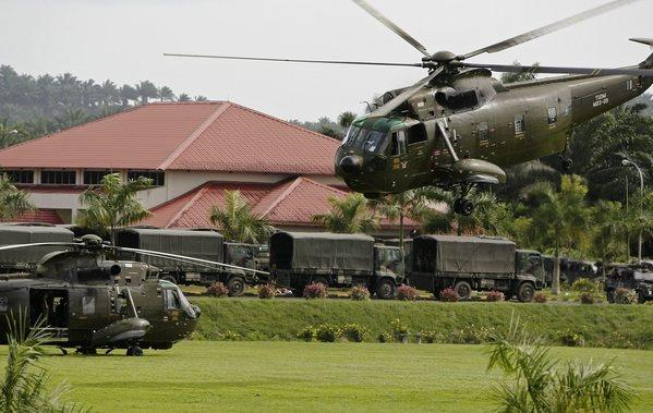 Malaysian helicopters and vehicles are seen at a temporary army base camp at Felda Sahabat in Malaysia's Sabah state on the island of Borneo. Malaysian troops attacked a group of Filipinos that has been occupying a town in the eastern state of Sabah.