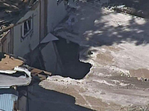 On Monday, workers exposed the sinkhole, seen in an image taken from video, that swallowed a Florida man in his home Thursday evening.